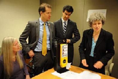 Karen Gourgey (right) demonstrates an APS to Council Members Mark Levine and Ydanis Rodriguez