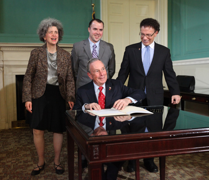 Dr. Karen Gourgey, Lester Marks, and Councilmember James Vacca join Mayor Bloomberg at the bill signing